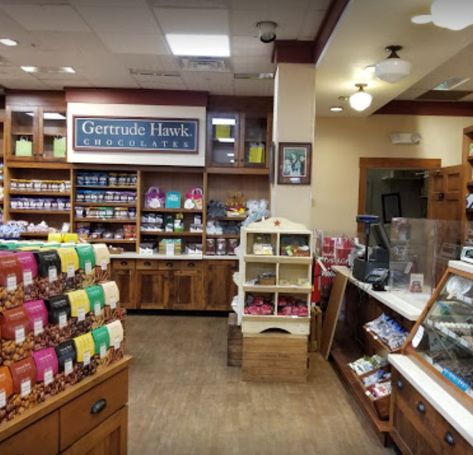 Gertrude Hawk Chocolates in Montgomery Mall bumbles inspection; Dead fruit fly like insects observed along wall adjacent, fruit fly like insect observed at wall adjacent to three basin sink system