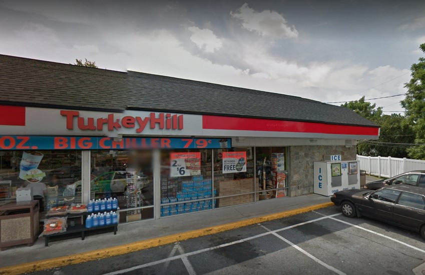 Millersville Turkey Hill bumbles inspection; No soap at hand sink, white mildew type residue and dust accumulation on the shelf units and racks in the walk-in cooler, 7 violations