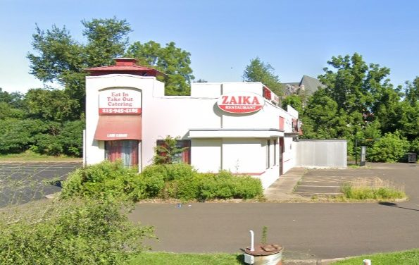 Inspection Zaika Kabab & Curry in Levittown; Fruit flies, Numerous rodent droppings were found in cabinetry below the self-service beverage dispenser