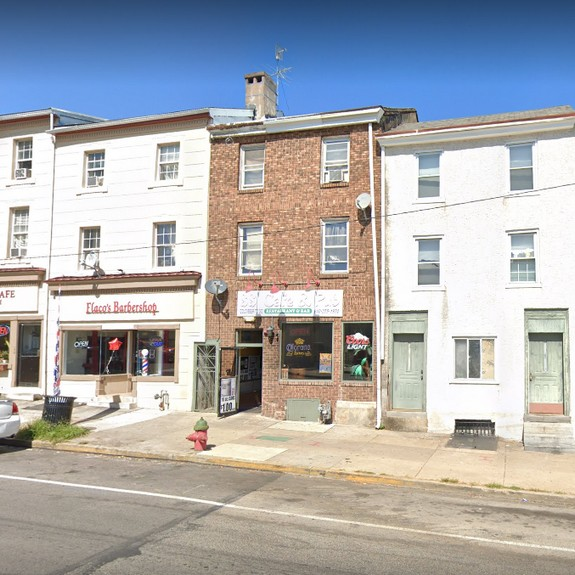 30 violations at 88 Cafe &Pub in Norristown; Mold-like growth on containers inside prep unit, Fly-like insects observed throughout facility, Plant growing out of junction of ceiling and exhaust hood at end of cooks line