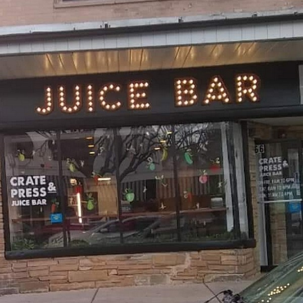 Crate and Press Juice Bar in Glenside fouls inspection; mold-like accumulation on inside top side walls of ice machine, cutting boards stored behind faucet of mop sink