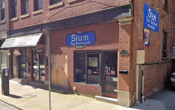 Inspection; Siam Thai Restaurant on 1st Ave in Pittsburgh; Brownish black residue on the edges of the deflector plate in the ice machine