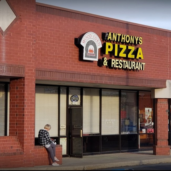 11 violations at Anthony's Pizza in Exton; cat beds, a scratching post and cat food on the floor of the kitchen indicating the presence of a live animal on the premise of the food facility