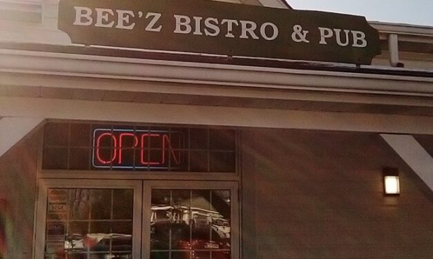 Bridgeville's Bee'z Bistro & Pub inspection ; Deflector plate in large ice machine near walk in cooler has pink mold-like substance