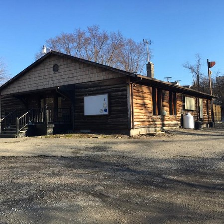 Yukon PA's Creekside Saloon hit for person smoking behind bar, no soap at hand sink during inspection, 7 violations