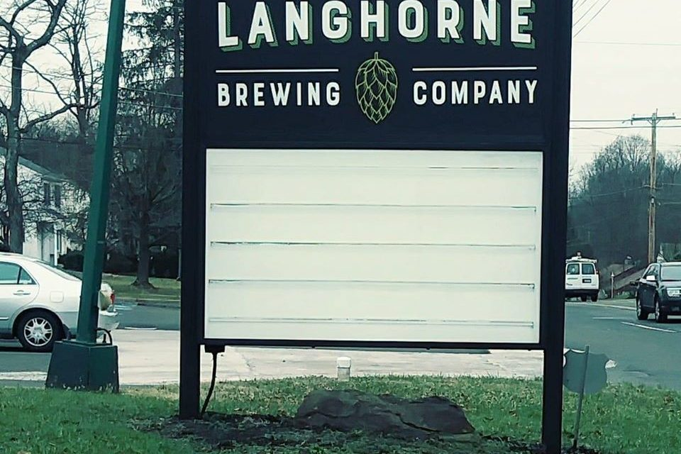 Langhorne Brewing Company fumbles inspection; ice maker has a back and orange mold-like substance forming, must clean and sanitize interior