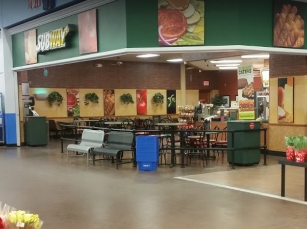 Warren Subway in Walmart fumbles inspection; Nozzles on the soda fountain, food contact surfaces, observed to have thick buildup of residue