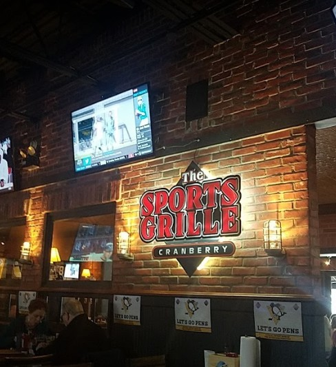 Sports Grille at Cranberry fumbles inspection, 10 violations, using rodent bait placed in bait stations which are not covered, Drawer on prep table has dried food residuals