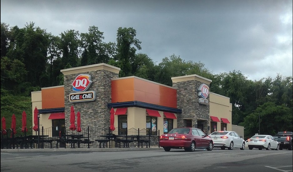 Irwin Dairy Queen fouls inspection; pink slime like substance on the drip tray and shield of ice machine, a food contact surface