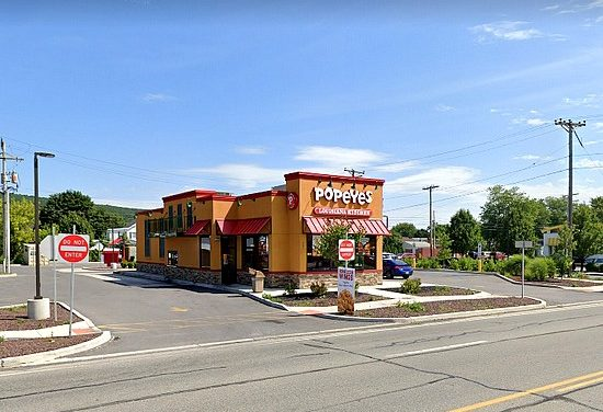 Inspection Popeye's in Altoona; Uncovered food stored under shelves with heavily soiled with black debris, 7 violations