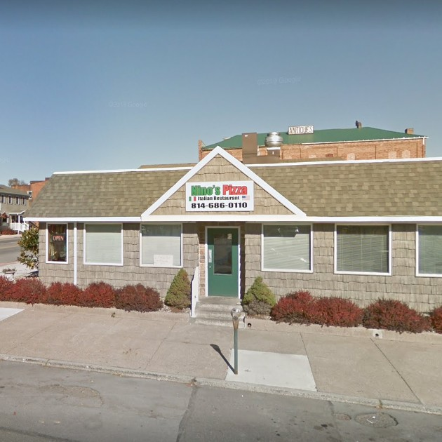 Nino's Pizza in Tyrone fumbles inspection; Inside the ice machine on the lip is a build of a slime debris, Build up of a heavy dirt debris noted on metal shelves inside the upright reach in cooler and in the walk in-cooler