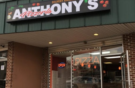 Inspection Anthony's Pizza Levittown; No masks, dried food particles on slicer, Soiled knives stored between equipment