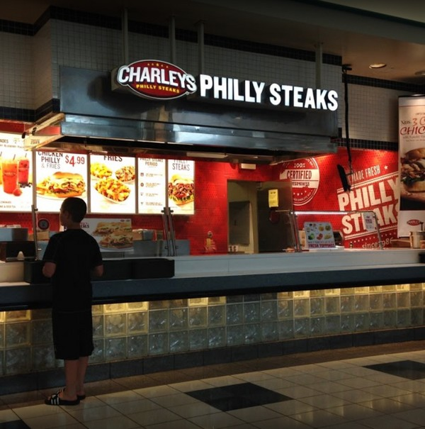 Charley's Philly Steaks in Westmoreland Mall inspection; Black filth observed on the interior of the ice machine, Employee observed eating or tasting food in the back prep area