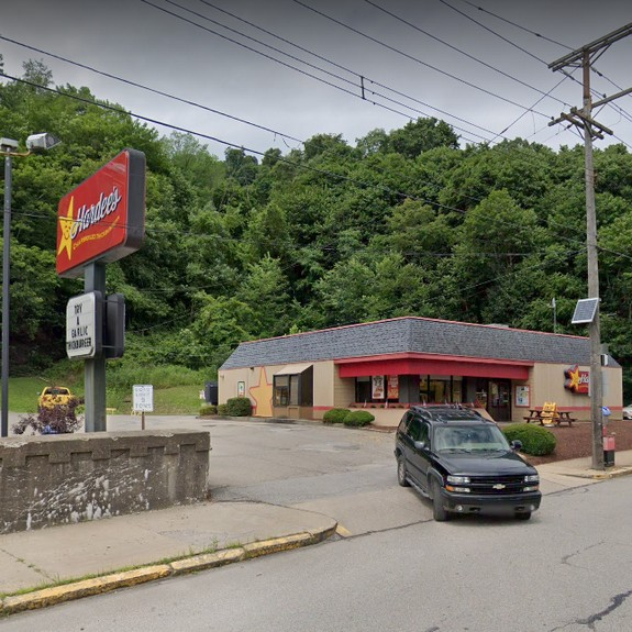 Complaint Inspection at Hardee's in Millvale; Swarms of fruit flies by office desk and by storage area near restrooms