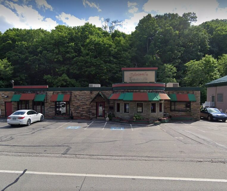 Inspection at Silvioni's just outside Pittsburgh; mold-like substance growing walls of  beer cooler, Employee observed with bare hand contact on bread for a sandwich