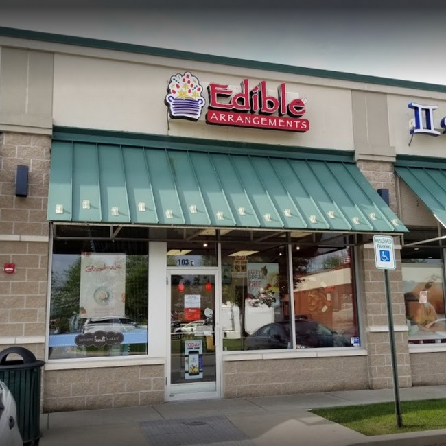 Inspection Edible Arrangements in Allentown; Ice machine with food residue and black mold-like build-up, Floors throughout the kitchen and walk-in cooler areas of the food facility is extremely dirty, dusty, and have a build-up of food-debris
